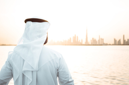 business man in dubai at sunset time