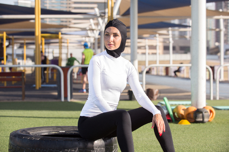Arabic woman running outdoor and wearing hijab