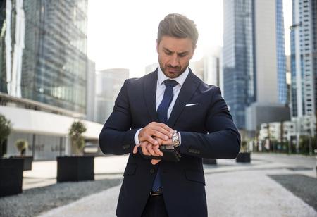 Handsome caucasian businessman - Portrait of a businessman walking outdoors