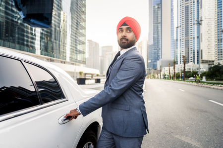 Punjabi businessman portrait outdoors - Hindi man wearing formal elegant suit Stock Photo