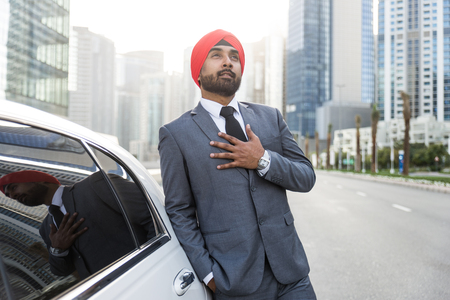 Punjabi businessman portrait outdoors - Hindi man wearing formal elegant suit Stock Photo