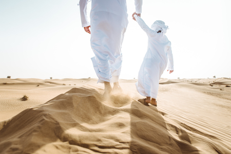 Father and son spending time in the desert Imagens