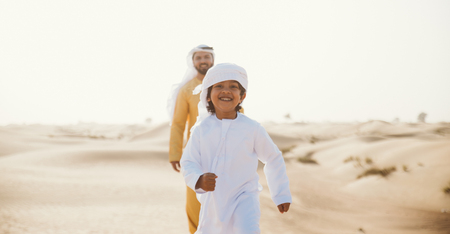 Father and son spending time in the desert Stock Photo