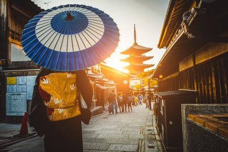 Japanese woman wearing traditional dress at Yasaka Pagoda, Kyoto