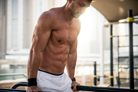 Beautiful man doing work out and different exercises outdoor Stock Photo - 100842655