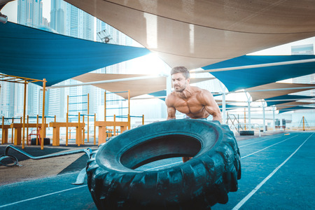 Beautiful man doing work out and different exercises outdoor Stock Photo - 100842664