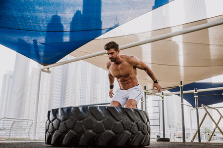 Beautiful man doing work out and different exercises outdoor Stock Photo - 100841686