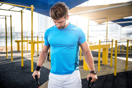 Beautiful man doing work out and different exercises outdoor Stock Photo - 100903507