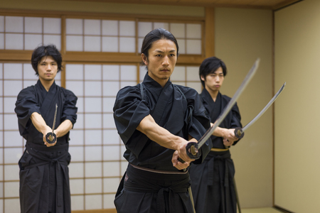 Japanese martial arts athlete training kendo in a dojo - Samaurai practicing in a gym Stok Fotoğraf