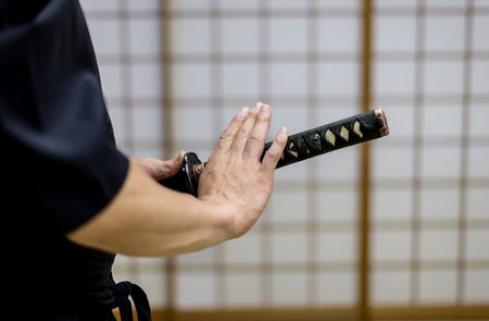 Japanese martial arts athlete training kendo in a dojo - Samaurai practicing in a gym Stock Photo - 101181555
