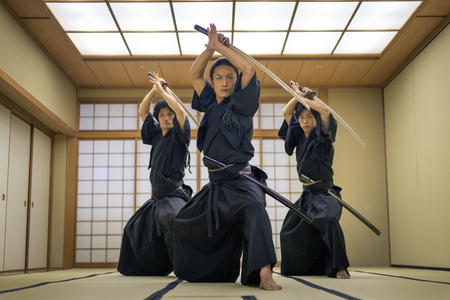 Japanese martial arts athlete training kendo in a dojo - Samaurai practicing in a gym 스톡 콘텐츠
