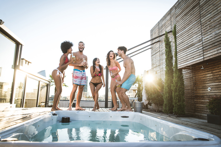 Multi-ethnic group of friends having party on  rooftop - Happy people bonding and having fun Фото со стока - 101176528