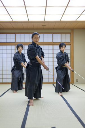 Japanese martial arts athlete training kendo in a dojo - Samaurai practicing in a gym Zdjęcie Seryjne