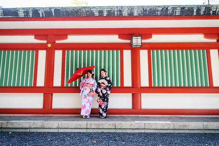 Two beautiful girls with traditional dress walking outdoors 版權商用圖片