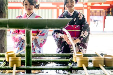 Two beautiful girls with traditional dress walking outdoors Banco de Imagens