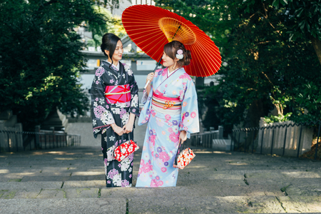 Two beautiful girls with traditional dress walking outdoors Фото со стока