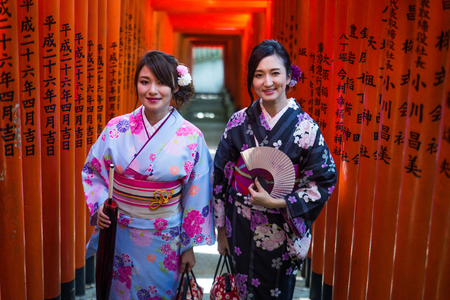 Two beautiful girls with traditional dress walking outdoors Editorial
