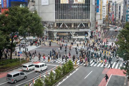 Tokyo, Japan - October 20, 2017: People and traffic at Shibuya Crossing. Scramble crossing in ShibuyaTokyo is famous landmark of Tokyo for nightlife and business in Shibuya.