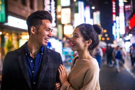 Beautiful happy couple dating in Tokyo Banco de Imagens