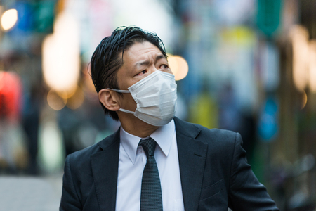 Japanese businessman walking outdoors - Asian man with elegant suit