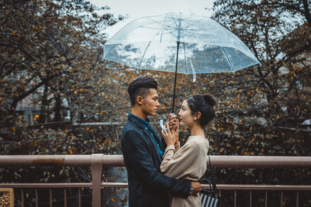 Beautiful happy couple dating in Tokyo Imagens