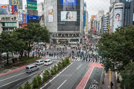 Tokyo, Japan - October 20, 2017: People and traffic at Shibuya Crossing. Scramble crossing in ShibuyaTokyo is famous landmark of Tokyo for nightlife and business in Shibuya.