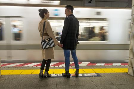 Beautiful happy couple dating in Tokyo Foto de archivo