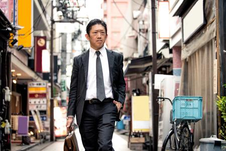 Japanese businessman walking outdoors - Asian man with elegant suit Stock fotó - 101658176
