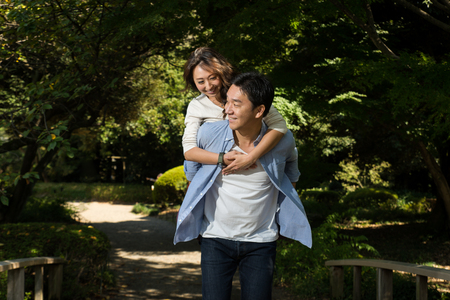 Beautiful asian couple dating in a park - Japanese man and woman having fun outdoors Stok Fotoğraf