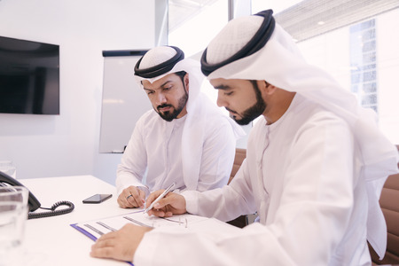Arabian men meeting and talking about business - Businessmen portrait in Dubai Stock Photo - 102502966