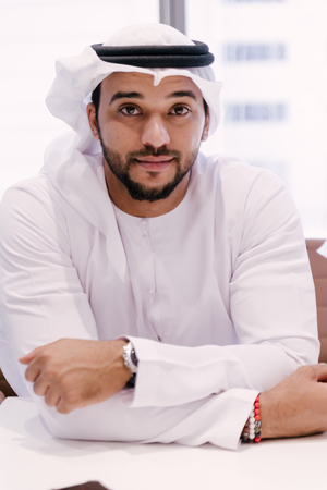 Emirati businessman looking at camera Stock Photo
