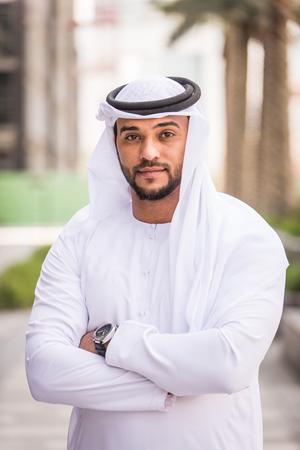 Arabian businessman portrait on grey background