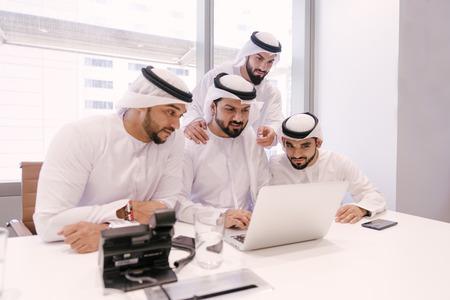 Arabian men meeting and talking about business - Businessmen portrait in Dubai