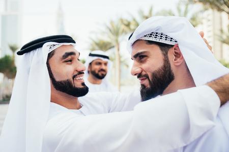 Group of businessmen talking on the street in Dubai Reklamní fotografie
