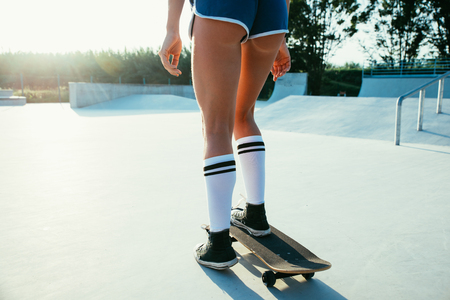 Beautiful skater girl lifestyle moments in a skatepark Stock Photo