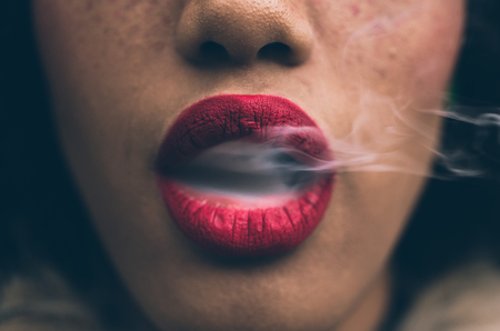 Woman smoking, close up on smoke and mouth Banco de Imagens - 104294091