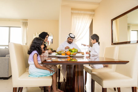 Happy arabian family having fun at home
