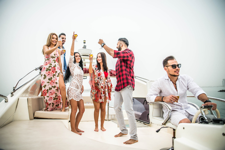 Group of friends making party on a yacht in Dubai - Happy people having a fancy party on a luxury boat Фото со стока - 105378611
