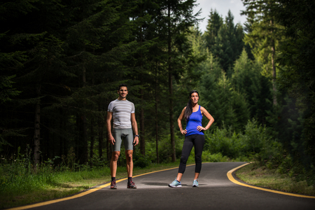 Couple running outdoors - Two athletes training in the forest