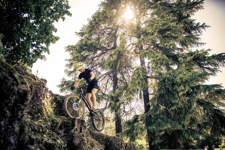 Man doing tricks with his acrobatic bike Stock Photo