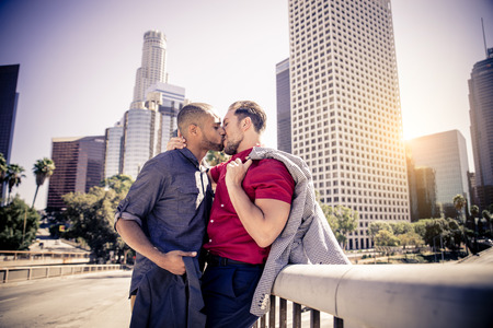 Homosexual couple at a romantic date outdoors - Multi-ethnic couple in love flirting and having fun Stockfoto