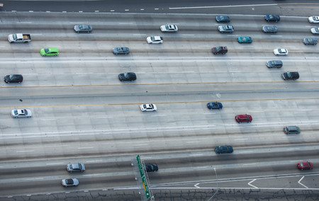 Cars driving on a highway, birds eye view 스톡 콘텐츠