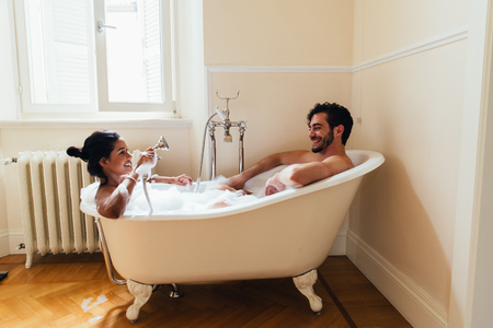 Couple in love spending time together in the house. Romantic moments in the bathroom