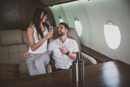 Couple on vacation, flying on their private jet