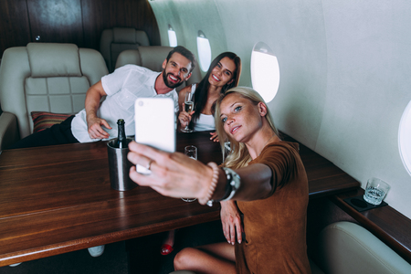 Group of friends going on vacation with a private jet