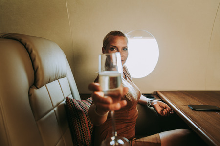 Beautiful woman traveling on her jet