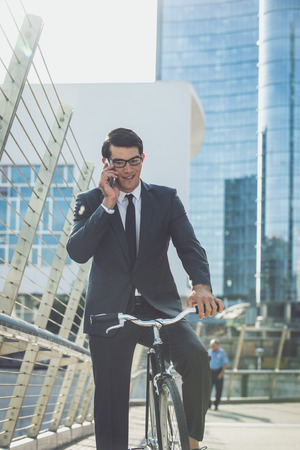 Handsome young business man with his modern bicycle. Stok Fotoğraf - 106768649