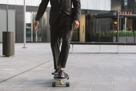 Handsome young business man with his modern longboard Stok Fotoğraf - 106769242