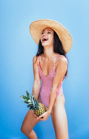Beautiful asian young woman with bikini. Portraits on colored backgrounds Standard-Bild - 106769351