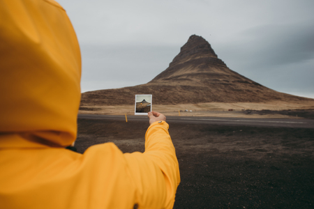 Man exploring icelandic lands. Photograph in the picture digitally created